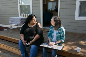 Sherry and Martha chat on the porch of Sherry's new home.