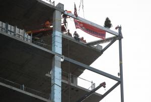 The final beam was lifted from the sidewalk on SW First Ave. up to the southwest corner of the 17th floor where it will remain a part of the building.