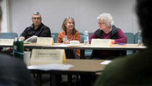 Rachel Clark, center, owner of the Goose Hollow Inn, speaks up during the final meeting of the food cart pod workgroup.