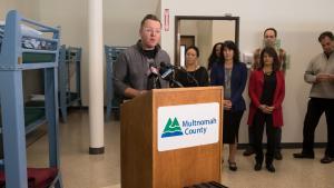 Andy Goebel of Portsmouth Union Church speaks at the Walnut Park shelter on Nov. 19, 2018.