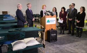 Brandi Tuck of Portland Homeless Family Solutions speaks before the opening of the community's winter family shelter in December 2018.