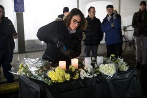 Commissioner Jessica Vega Pederson lights a candle.