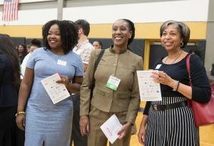 Patricia Charles-Heathers, center, chats with Interim mental health director Ebony Clarke, left and Clinical Services Director Vanetta Abdullatif, right, at a Say Hey! event in February.