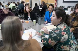 Members of the community discuss outreach with a representative from the U.S. Census Bureau and Commissioner Lori Stegmann.