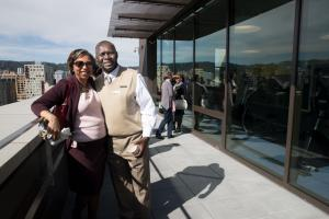 Clinic director Vanetta Abdellatif visits the Health Department roof deck with clinic advisory board member Harold Odhiambo