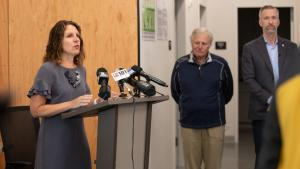 Chair Deborah Kafoury with Tim Boyle and Mayor Ted Wheeler at the River District Navigation Center on Aug. 26, 2019.