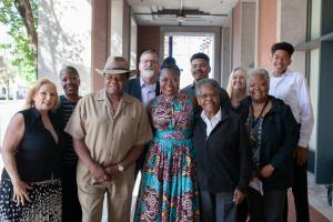 Newly appointed Department of Community Justice Director Erika Preuitt poses with family, including her father, Norman Sylvester (left) and mother Carmen Sylvester  (right)