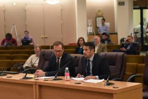 County Attorney Will Glasson, left, and Chief Financial Officer Eric Arellano brief the Board on the tourism taxes agreement Sept. 19, 2019.