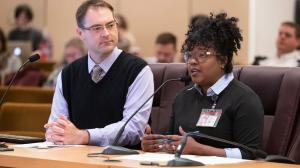 Ebony Clark, director of Mental Health and Addiction Services, right, lays out the preliminary program proposal for a downtown behavioral health resource center.