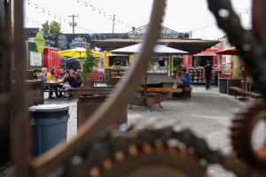 Food cart pods create community gathering spaces in otherwise vacant lots.