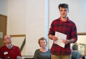 Elijah Cetas speaks along with Dan Serres and Jonna Papaefthimiou.