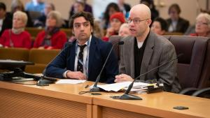 Chris Voss, director of Multnomah County's Office of Emergency Management, right, testifies alongside John Wasiutynski, director of the County's Office of Sustainability
