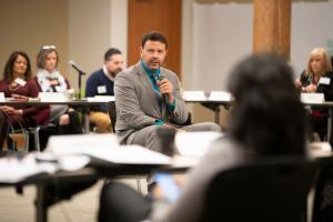 Travis Parker, Program Area Director with Policy Research, Inc. spoke at Thursday's conference.