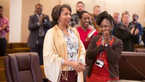 Integrated Clinical Services Director Vanetta Abdellatif, left, is cheered on her last day by interim director Tasha Wheatt-Delancy