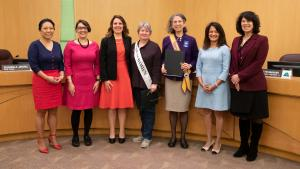 Board of County Commissioners pose with past and present board presidents of the League of Women Voters.