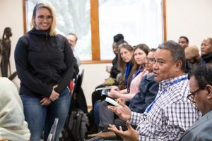 IRCO staff member Kolini Fusitua speaks up during a workshop on COVID-19.