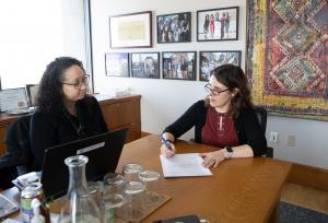 Chair Deborah Kafoury, right, signs a declaration of emergency in response to COVID-19 alongside Public Health Director Rachael Banks.