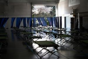 County employees work to set up temporary shelter space at the Oregon Convention Center on Friday, March 20, 2020.