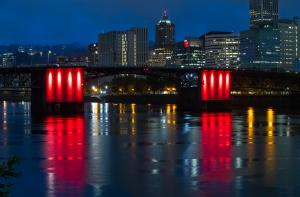 The Morrison Bridge is lit red to honor missing and murdered indigenous women and girls, May 2021
