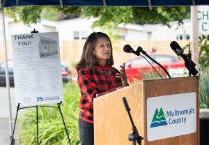 Commissioner Susheela Jayapal speaks during a ceremony to thank supporters of the St. Johns Village on May 21, 2021.