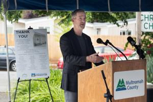 Mayor Ted Wheeler speaks during a ceremony to thank supporters of the St. Johns Village on May 21, 2021.