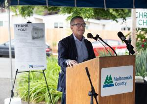 City Commissioner Dan Ryan speaks during a ceremony to thank supporters of the St. Johns Village on May 21, 2021.