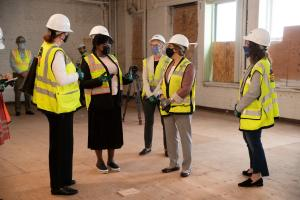 Health Department Director Ebony Clarke speaks to Congresswoman Suzanne Bonamici during a tour of the Behavioral Health Resource Center, July 2021