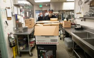 Mental Health Unit officers John McVay and Joe Wenhold pick up meals prepared by the County's Juvenile Services Division's Courtyard Café and Catering Service.