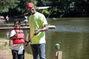 """Will Warren (right) is President and Chief Executive Officer of I'm Hooked, a nonprofit organization dedicated to creating and organizing activities that connect youth to nature and """"enrich young lives with skills that can be used over a lifetime."""""""""""