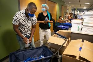 DCHS assembled 2,000 cooling kits for our vulnerable population. From left are DCHS team: Innocent Kisanga, Yvonne Flores, Margot Woods, and a community volunteer (facing back), July 30, 2021