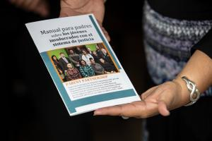 The parent handbook — produced in English and Spanish — provides a glossary of common justice terms, tips for court appearances and important contacts for parents.