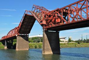 The Broadway Bridge bascule spans can open for river traffic to pass.