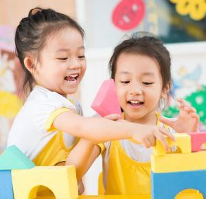 Preschoolers Building with Blocks