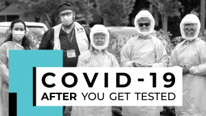 COVID-19 testing staff dressed in personal protective equipment