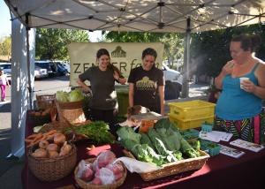 Angela Reed, right, samples veggies at the CSA Partnership Celebration