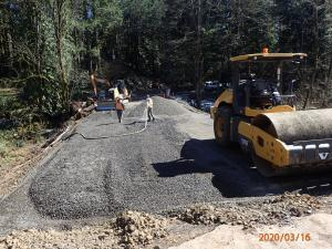 Compacting gravel at NW Rock Creek Road above new culvert, 3-16-2020