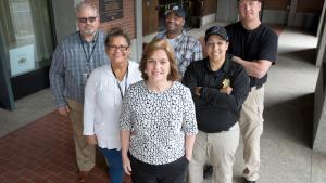 From left: Juvenile Services Division (JSD) Manager Dennis Moore; JSD Counselor Silvia Gomez; Parole and Probation Officer (PPO) Keith Murphy; Adult Services Division Manager Kate Desmond (center); PPO Brie Murphy and PPO Erik Zilz.