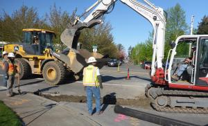 Demolition  work at NE 238th Drive and Oregon St where ADA ramps and new sidewalk will be built.