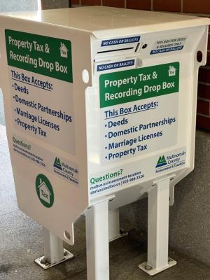 24-hour document drop box at Multnomah Building entrance