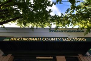 Front entrance sign that says Multnomah County Elections