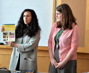 Elena Gold, a library assistant at Belmont Library and Gesse Stark-Smith, a community outreach librarian, teach newly-arrived refugees about library services before distributing new picture dictionaries to each family.