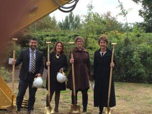 Multnomah County Commissioners pose with smiles and shovels
