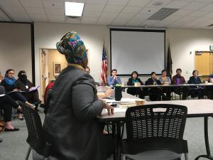 Debbie Clavon, front left, speaks during the East County Caring Community's March 2, 2017, meeting.