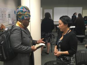 Debbie Clavon, left, talks with Multnomah County Commissioner Lori Stegmann after the East County Caring Community meeting March 2.