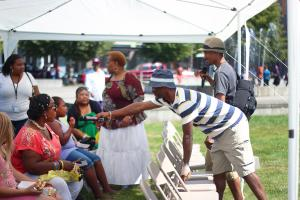 Creative director and Wellness Team member Raz Robertson conducts a health quiz at a recent Highland Haven festival.