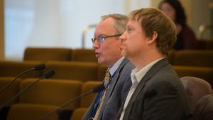 Multnomah County Courthouse Project Manager speaks to the board as Climate and Energy Coordinator Tim Lynch listens.