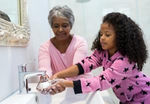 gramma and grandaughter together washing hands