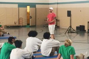 Noah Schultz talking to youth