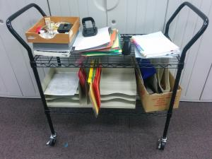Office Supplies Frequently Surplused: File Folder, post it note caddy, desk organizer, paper, hole punch.