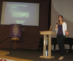 Woman presenting at a church